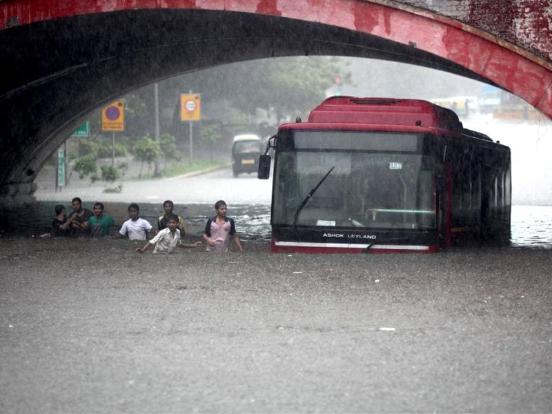 A DTC bus stuck at the flooded Minto Road underpass after heavy shower in New Delhi. PTI Photo