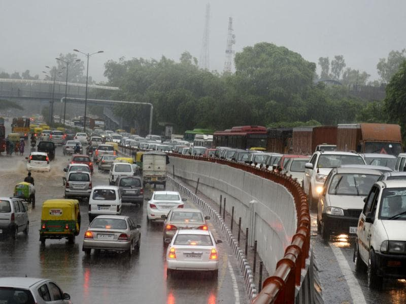 Traffic snarl on the approach road to the Kalkaji flyover in New Delhi after torrential rains lashed the city. (Shubham Gupta/HT Photo)