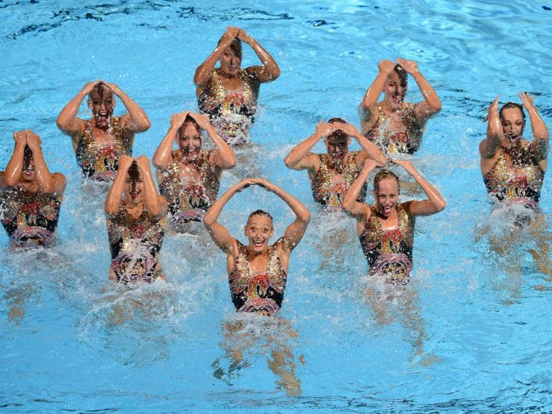 Canada's synchronised swimming team compete in the team free combination preliminary round during the synchronised swimming competition in the FINA World Championships at the Palau Sant Jordi in Barcelona, Spain. (AFP Photo)