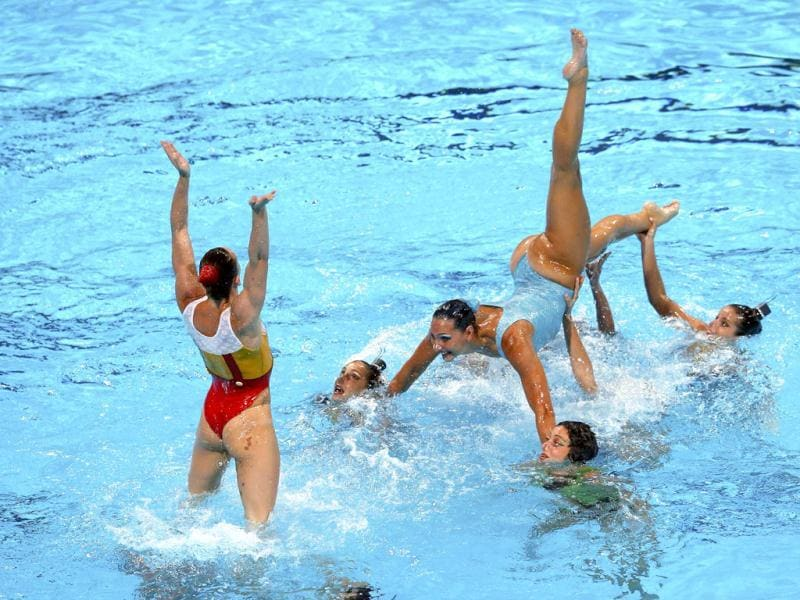 Italy's team perform in the synchronised swimming free combination routine preliminaries during the World Swimming Championships at the Sant Jordi arena in Barcelona, Spain. (Reuters)