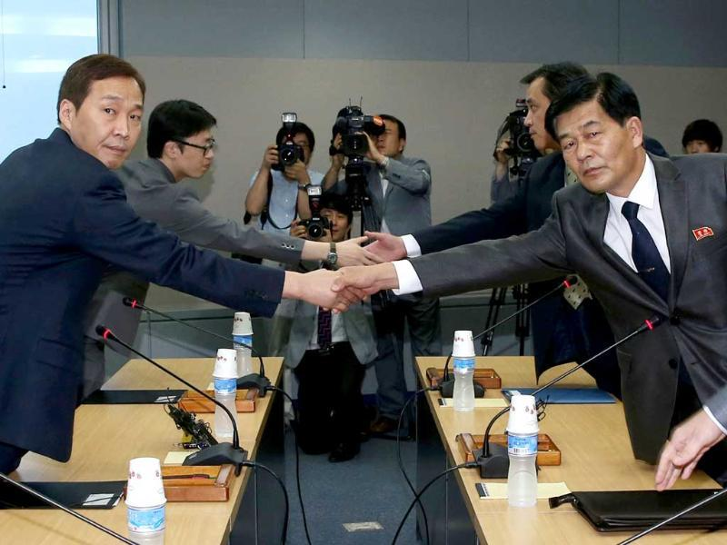 Head of the South Korean working-level delegation Kim Ki-woong (L) shakes hands with his North Korean counterpart Park Chol-su during their talks at the Kaesong Industrial District Management Committee in Kaesong. South and North Korea began their fifth working-level talks on Monday to discuss normalisation of operations at the jointly run industrial park, including the resumption of facility inspections, reported local media.  REUTERS