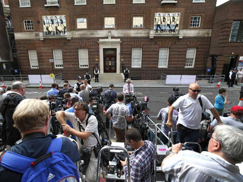 Members of the media wait for news of the royal baby across from St. Mary's Hospital exclusive Lindo Wing in London. (AP Photo)