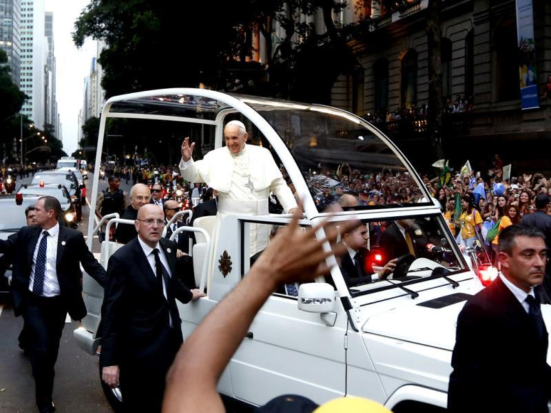 A crowd of faithful cheer as Pope Francis rides in his popemobile in Rio de Janeiro, Brazil. (AP photo)