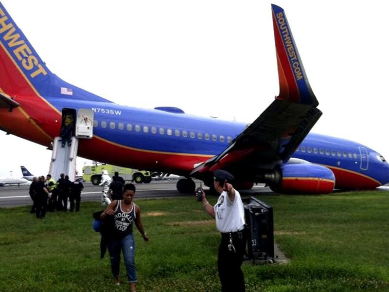 A Southwest Airlines plane sits on the tarmac as passengers disembark at LaGuardia airport in New York after it landed without its nose gear. Reuters