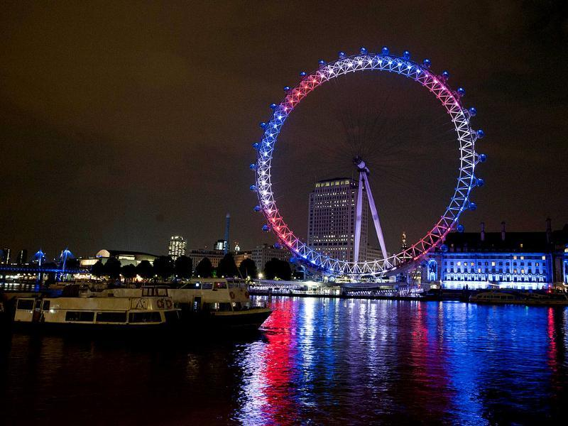 The London Eye is illuminated in celebration of the birth of a baby boy for Britain's Prince William and his wife Catherine, the Duchess of Cambridge in London. AFP
