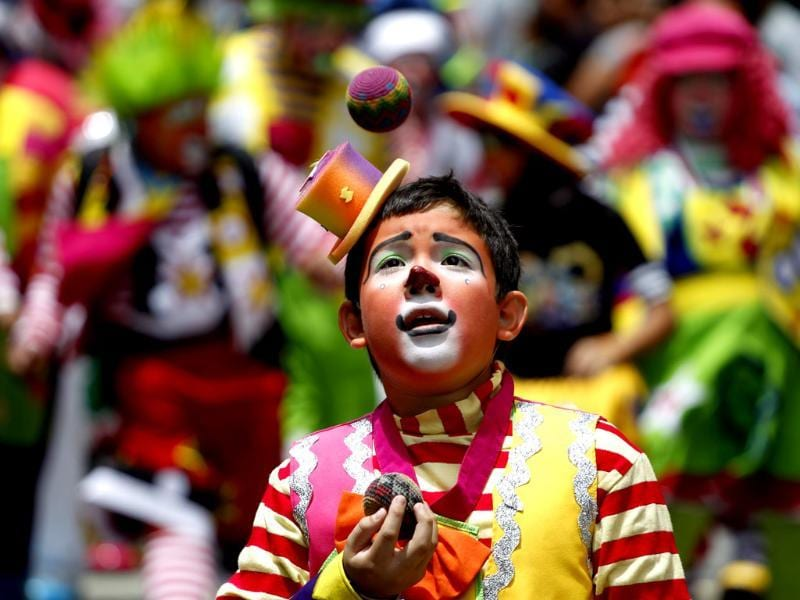 A clown juggles during a parade to inaugurate the 5th Annual Clowns' Convention in Guatemala City. Reuters photo