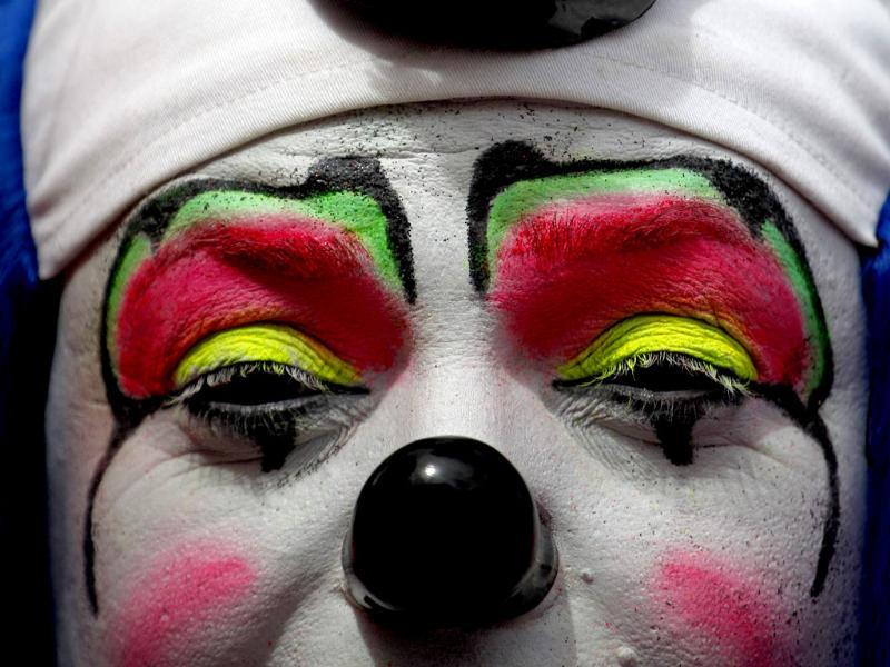 A clown poses for a picture during a parade to inaugurate the 5th Annual Clowns' Convention in Guatemala City. Reuters