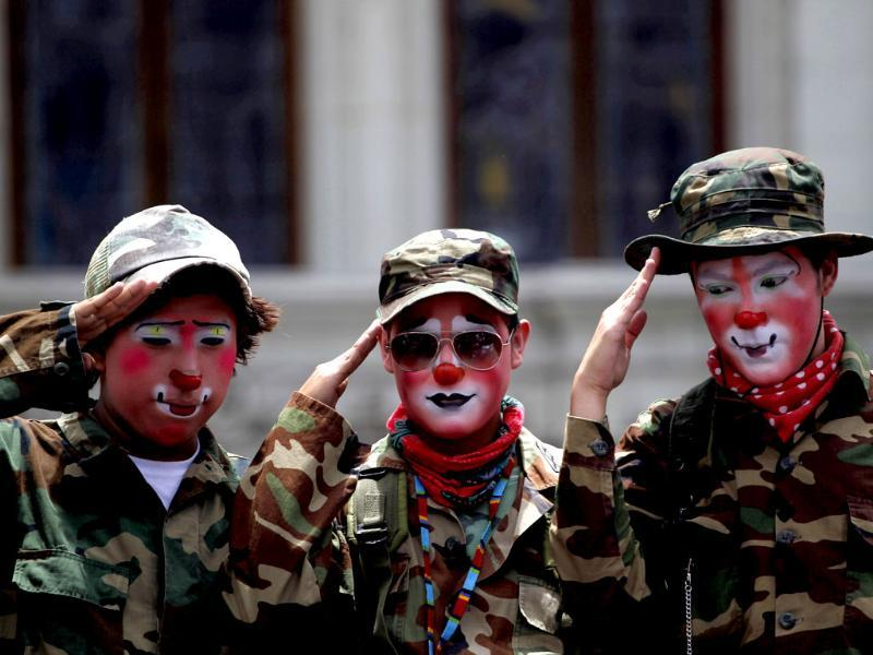 Clowns dressed as soldiers salute during a parade to inaugurate the 5th Annual Clowns' Convention in Guatemala City. Reuters