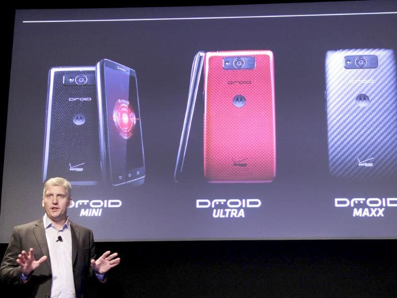 Rick Osterloh, a Senior Vice President with Motorola, discusses three new smartphones offered by Verizon, in New York. From left to right are the Motorola Droid Mini, Droid Ultra and Droid Maxx. Photo: AP/Mark Lennihan