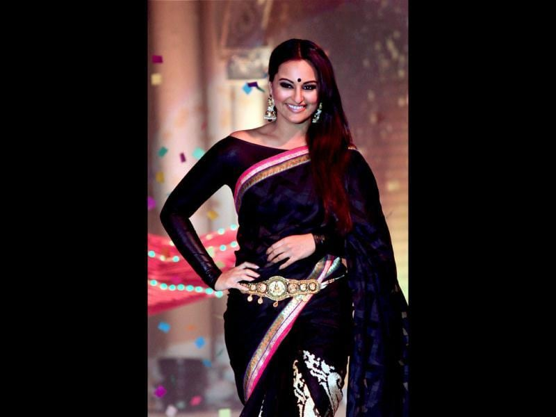 Sonakshi glams up the look with a boat neck blouse. (PTI Photo)