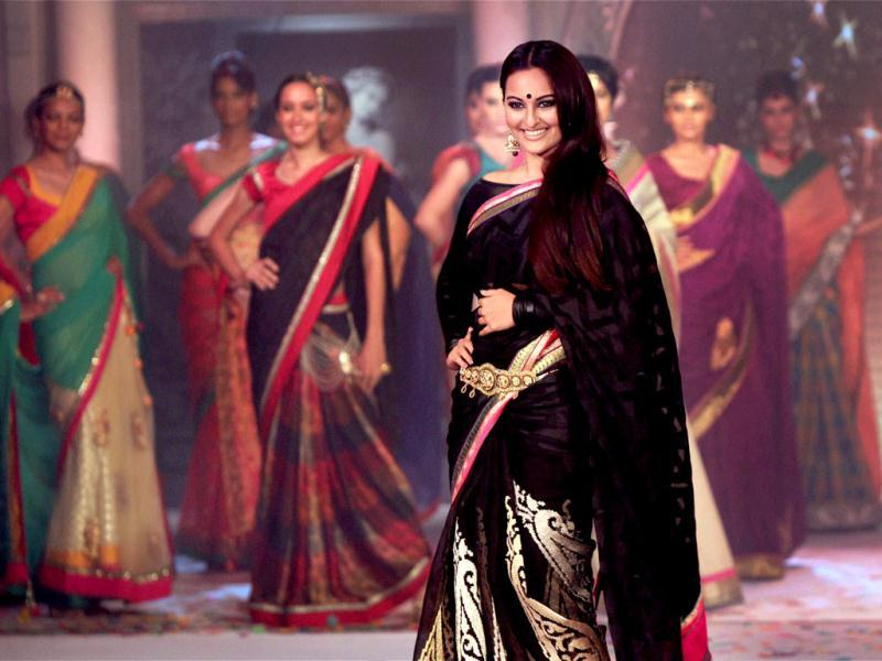Bollywood actress Sonakshi Sinha, known for her ethnic style, pulls off this black sari with a lot of grace at a fashion show in Bengaluru. (PTI Photo)
