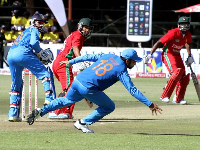 Virat Kohli attempts to stop the ball during the one day match against Zimbabwe in Harare. (AP Photo)