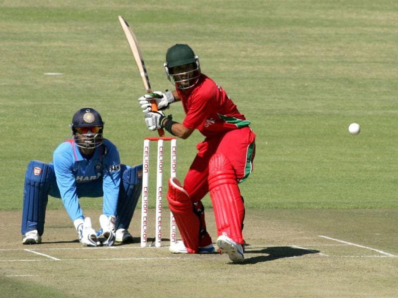Zimbabwe's batsman Sikanda Raza Butt hits the ball as wicket keeper Dinesh Kathik looks on during the first of the five ODI cricket series matches between India and hosts Zimbabwe at the Harare Sports Club. (AFP photo)