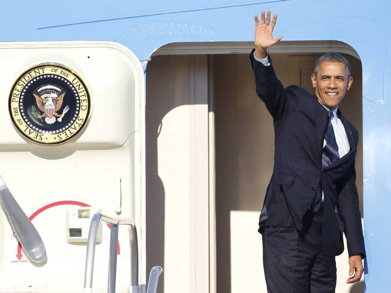 President Barack Obama waves as he boards Air Force One at Whiteman Air Force Base in Knob Noster, Mo. (AP Photo)
