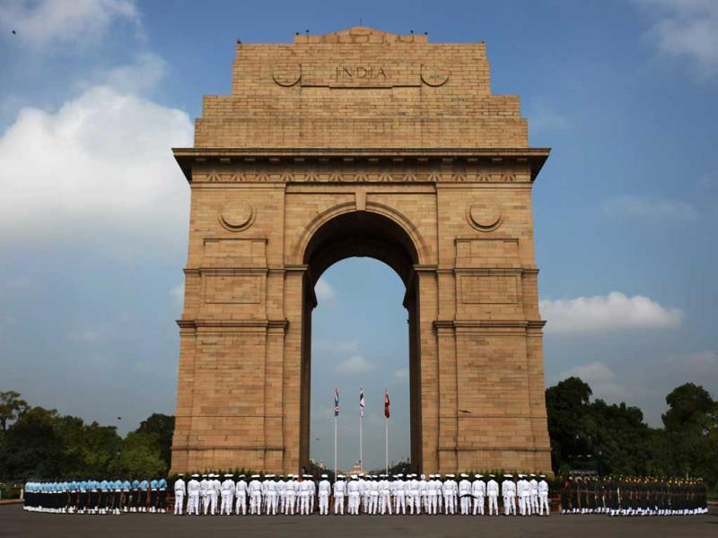 Soldiers from the three defense forces pay tribute at India Gate war memorial on the 14th anniversary of India's victory in the Kargil War in New Delhi, India. (AP Photo)