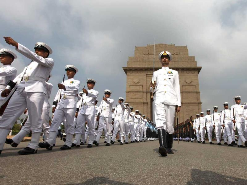 Indian navy personnel pay tribute at India Gate war memorial on the 14th anniversary of India's victory in the Kargil War in New Delhi. (AP Photo)