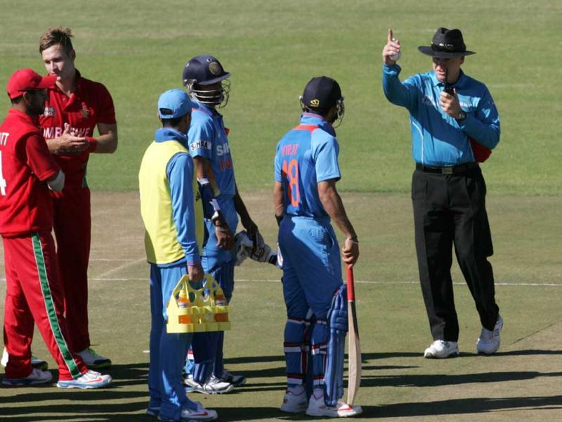 India captain Virat Kohli is given out by umpire Bruce Oxenford after a review during the second ODI against hosts Zimbabwe at the Harare Sports Club. (AFP Photo)
