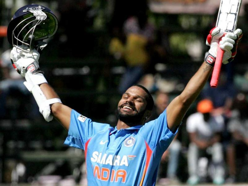 India's Shikhar Dhawan celebrates his century during the second ODI against Zimbabwe at the Harare Sports Club, in Harare. (AFP Photo)