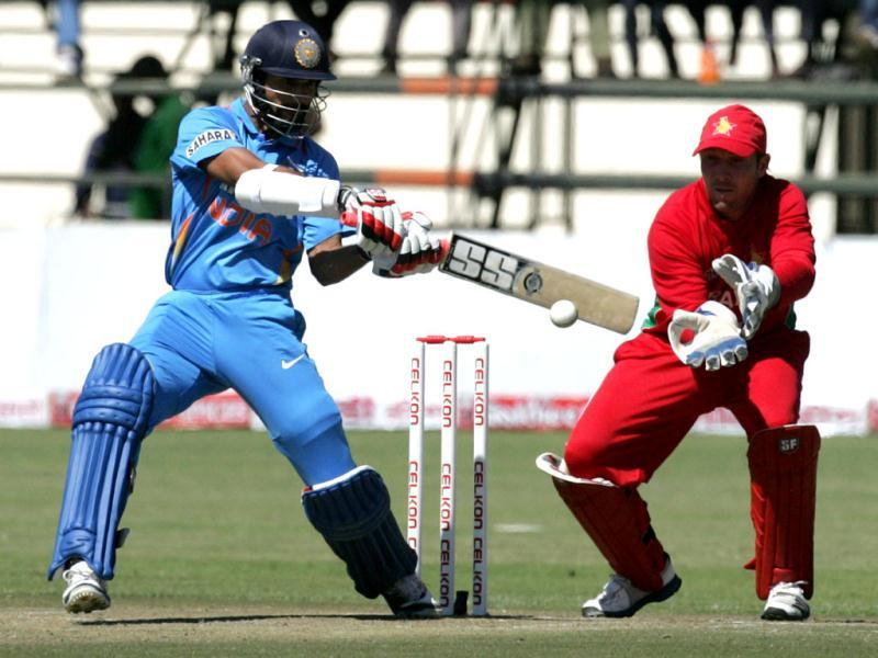 India's Shikhar Dhawan bats as Zimbabwean captain Brendan Taylor looks on during the second ODI between Zimbabwe and India at the Harare Sports Club. (AFP Photo)