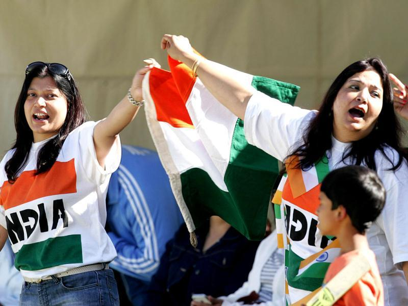 Supporters of the Indian cricket team wave the Tricolour during the second ODI against Zimbabwe at the Harare Sports Club. (AFP Photo)