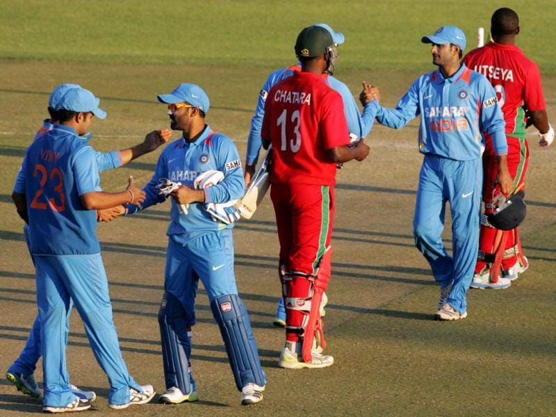 Victorious Indian players shake hands with Zimbabwe's players after winning the second ODI at the Harare Sports Club. (AFP Photo)