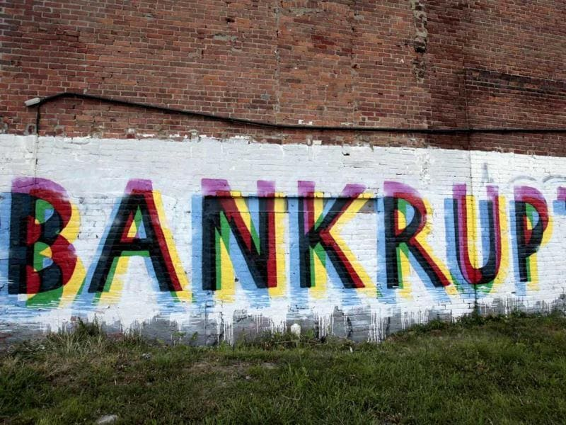 The word 'Bankruptcy' is seen painted on the side of a vacant building by street artists as a statement on the financial affairs of the city on Grand River Avenue in Detroit, Michigan. (Reuters)