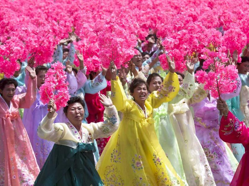 North Korean women wave to their leader Kim Jong Un during a mass military parade on Kim Il Sung Square in Pyongyang.(AP Photo)