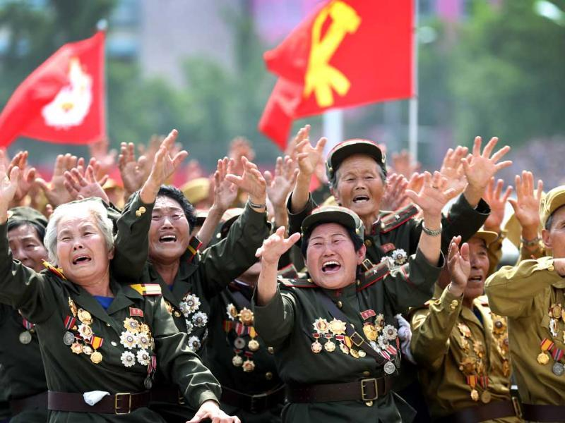 North Korean war veterans cry as they parade past their leader Kim Jong Un at the mass military parade in Pyongyang, North Korea. (AP Photo)