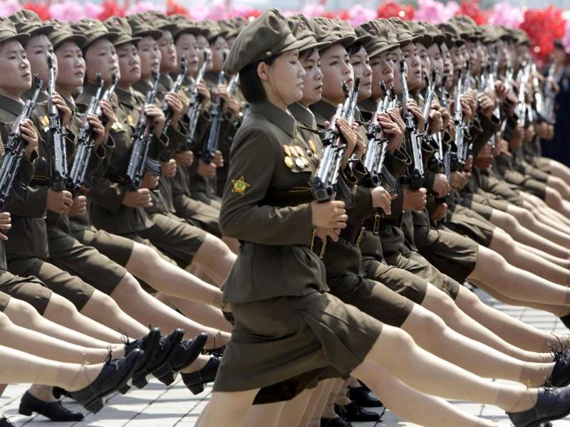 Women North Korean soldiers parade to mark the 60th anniversary of the signing of a truce in the 1950-1953 Korean War in Pyongyang. (Reuters Photo)