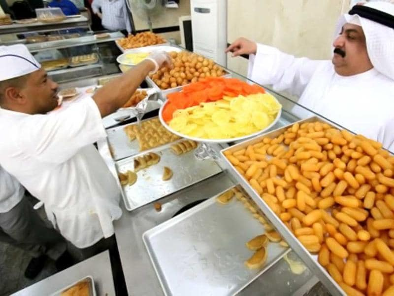 A customer orders sweets at a pastry shop during the Muslim fasting month of Ramzan in Kuwait. (AFP photo)