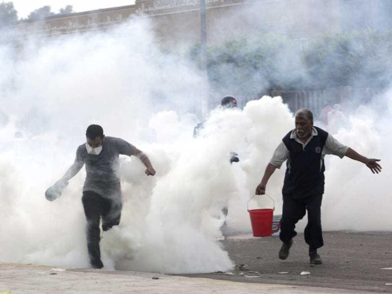 Supporters of deposed Egyptian President Mohamed Mursi run from tear gas fired at them by police during clashes in Nasr city area, east of Cairo July 27, 2013. REUTERS