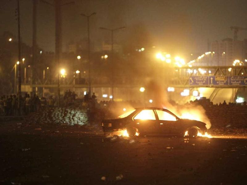 A car that members of the Muslim Brotherhood and supporters of deposed Egyptian President Mohamed Mursi say was burnt by police and plain-clothed people is seen during clashes in Nasr city area, east of Cairo July 27, 2013. REUTERS