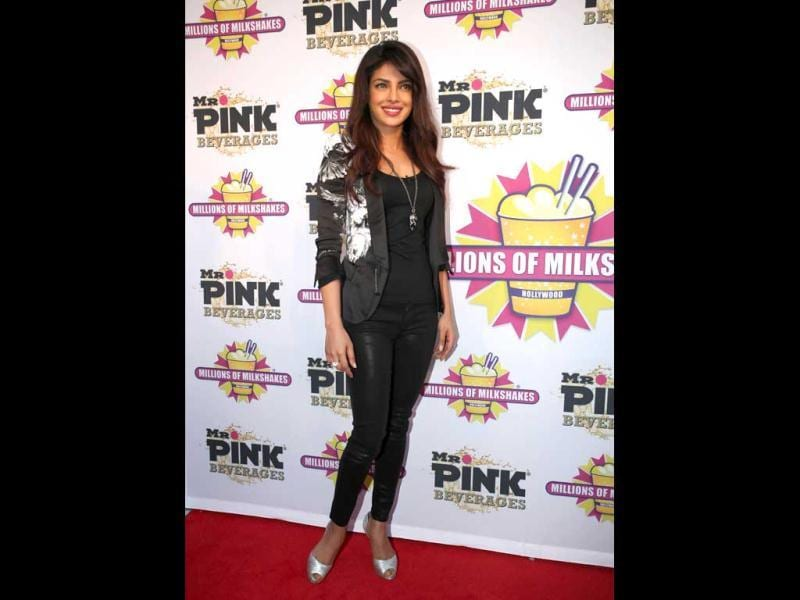 At the red carpet. Priyanka Chopra arrives to launch her 'Exotic' milkshake by the Mr Pink Beverages.