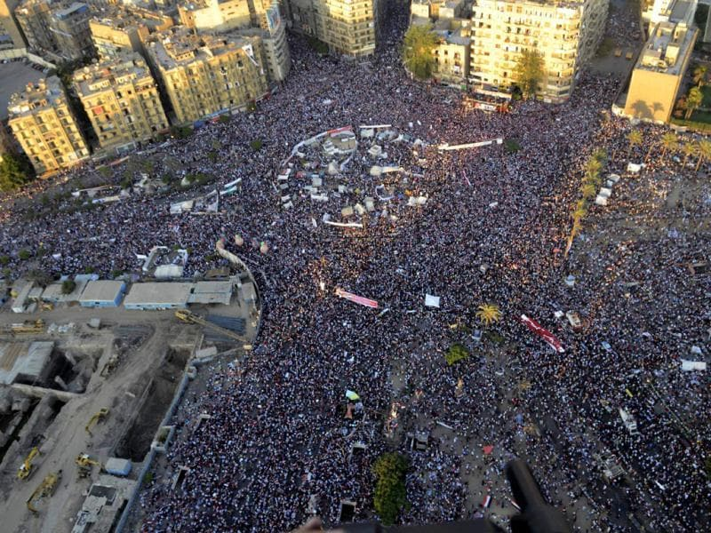 Egyptian army, opponents of Egypt's ousted President Morsi protest at Tahrir Square in Cairo, Egypt. (AP Photo)
