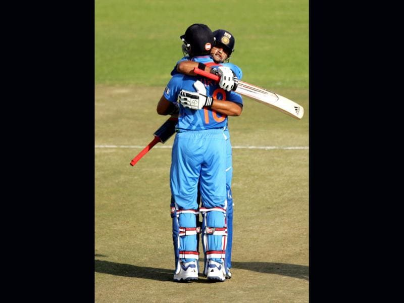 India's Virat Kohli (L) and Suresh Raina embrace after their victory against Zimbabwe in the third ODI at Harare Sports Club. (AFP Photo)