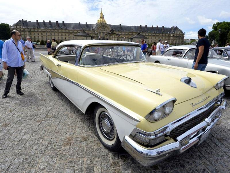 A Ford Motor Fairlane car stands in front of the Hotel Invalides in Paris during the