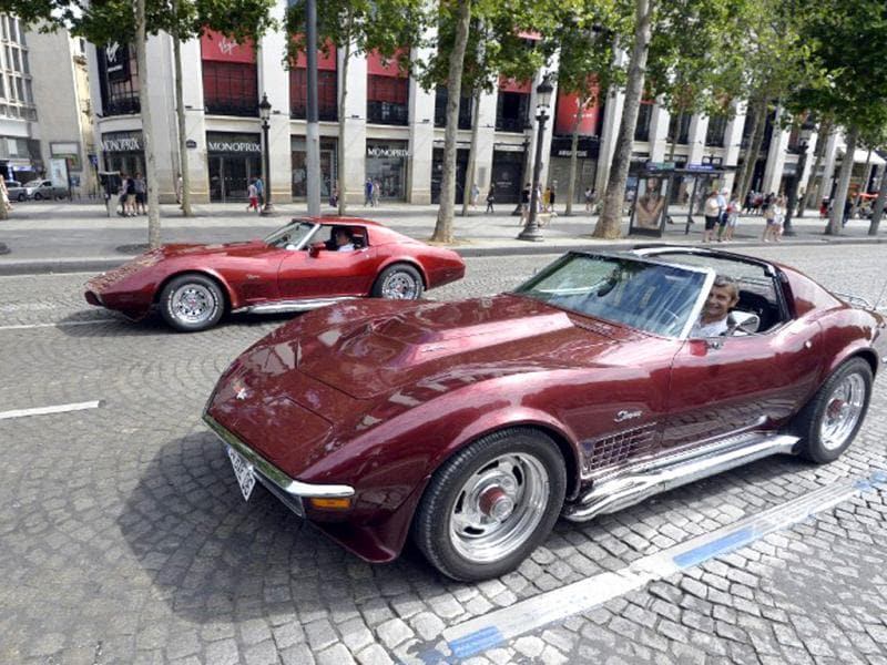 Two Corvette Stingrays drive down Paris streets during the