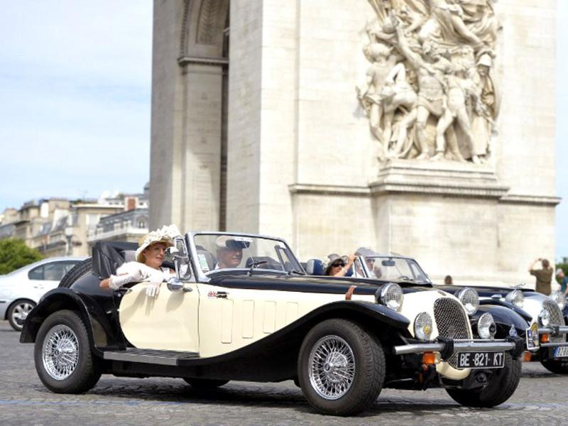 A convertible Bugatti takes part in the vintage cars parade as part of the sixth summer edition of the