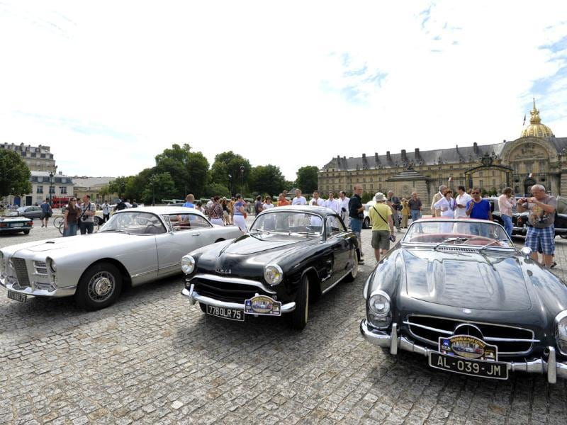 (From L) A Facel-Vega, a Simca and a convertible Mercedes Benz 190SL stand in front of the Invalides in Paris during the
