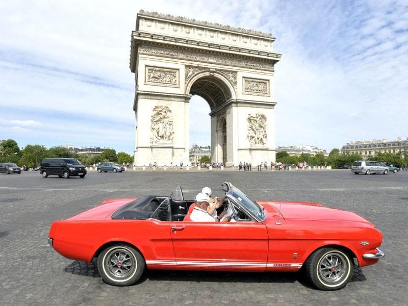 A convertible Ford Mustang in the vintage cars parade as part of the sixth summer edition of the