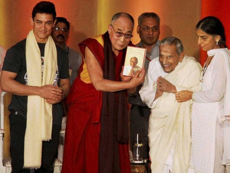 Tibetan spiritual leader Dalai Lama, spiritual leader Dada JP Vaswani and Aamir Khan during the launch of a book at an interactive session in Pune on Sunday. (PTI Photo)