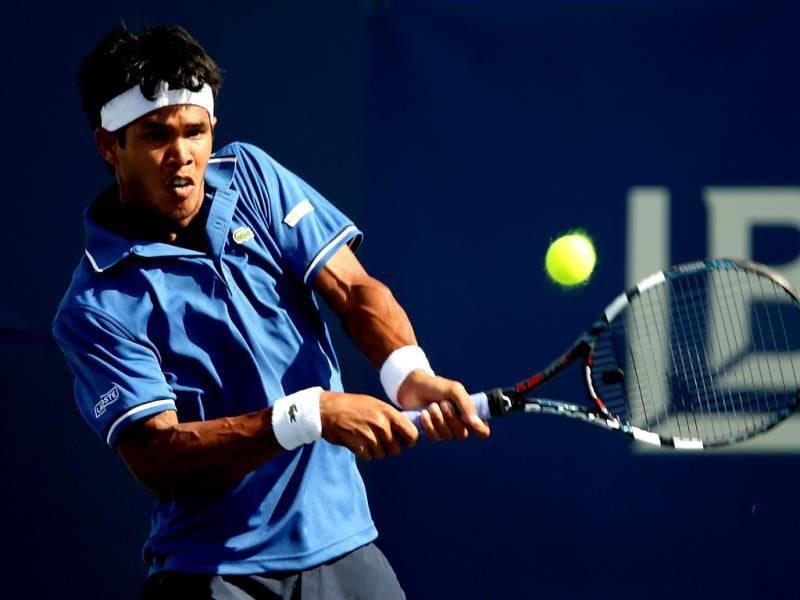 Somdev Devvarman of India returns a shot to Rhyne Williams during the Citi Open at the William HG FitzGerald Tennis Center in Washington, DC. (AFP Photo)