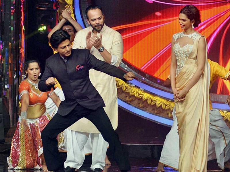 Shah Rukh Khan and Deepika Padukone promote Chennai Express on the sets of a TV show on Sunday. (PTI Photo)