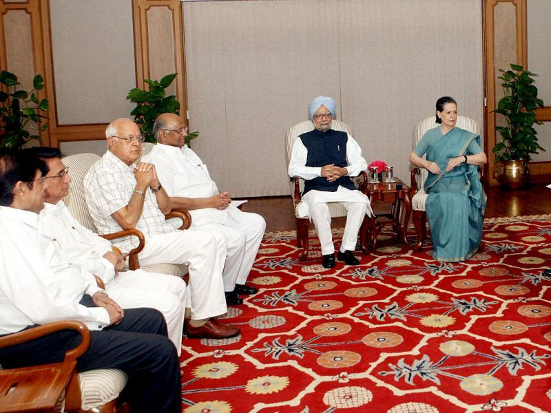 PM Manmohan Singh, UPA chairperson Sonia Gandhi and other leaders during the UPA meeting on Telangana at PM's residence in New Delhi. (PTI Photo)