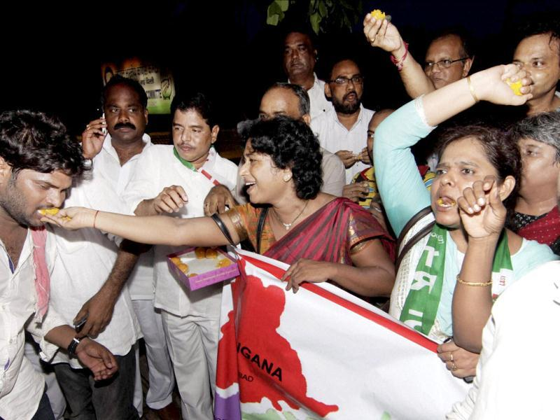 Telangana supporters celebrate outside AICC headquarters in New Delhi after Congress Working Committee endorsed a decision to create separate Telangana state. (PTI Photo)