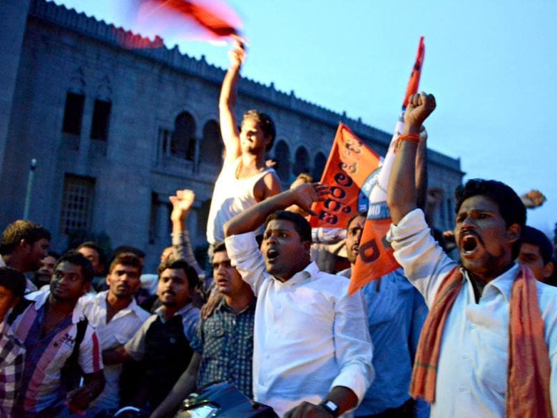 Osmania University students celebrate after the announcement of the separate state Telangana in Hyderabad. (AFP Photo)