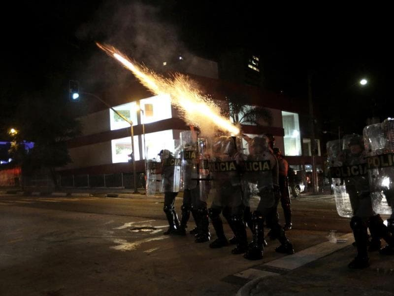 Military police fire tear gas at demonstrators of the group called Black Bloc during a protest against Sao Paulo State Governor Geraldo Alckmin, in Sao Paulo. (Reuters)