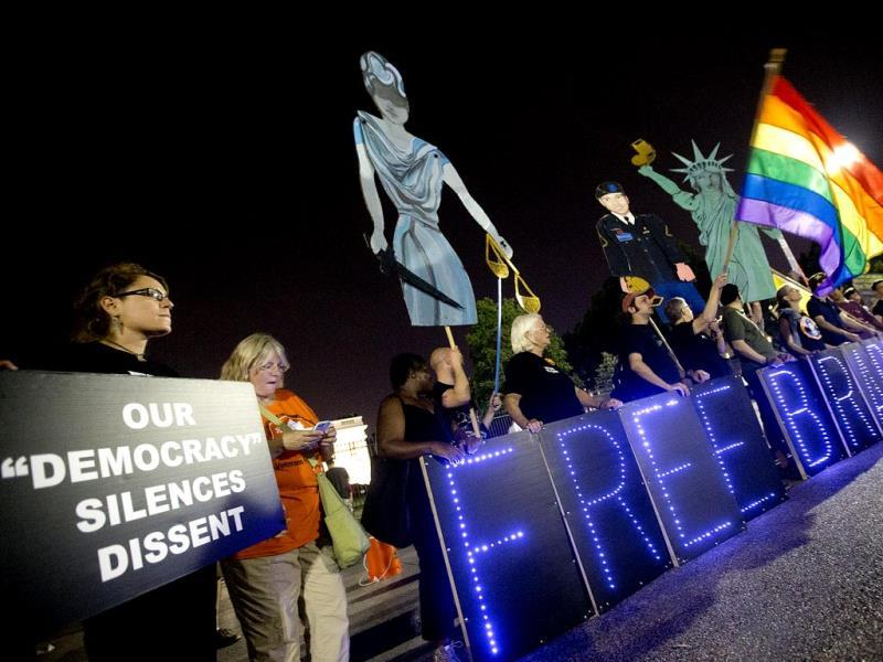 Supporters of Army Pfc. Bradley Manning demonstrate infront of the White House during a night time rally in Washington. (AP Photo)