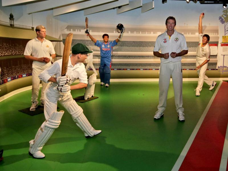 Former Australian cricket player Glenn McGrath (2nd R) poses among cricket legends (from left), Shane Warn, Donald Bradman, Sachin Tendulkar and a wax statue of himself (R) at Madame Tussauds in Sydney. (AP Photo)