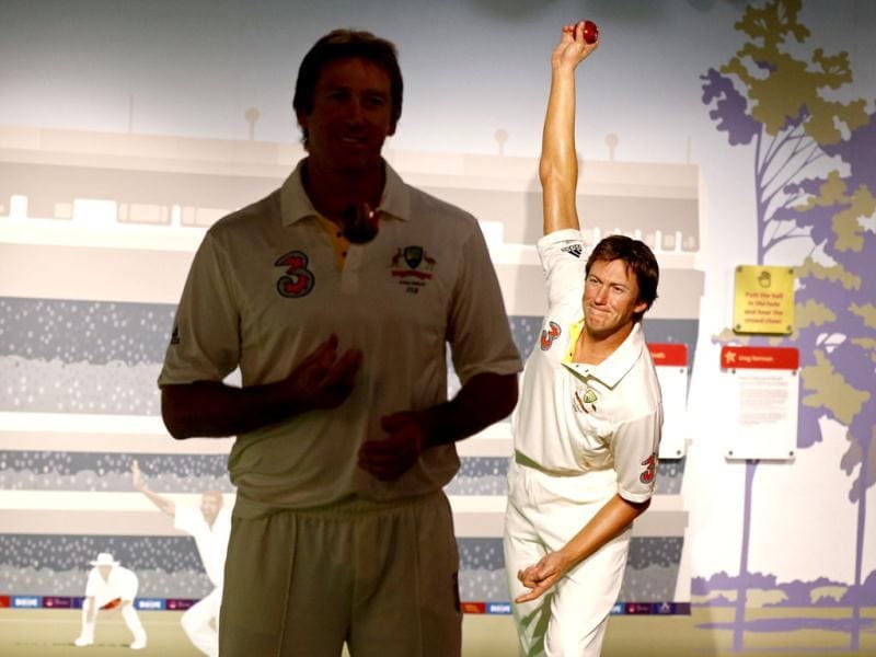 Former Australian cricket player fast bowler Glenn McGrath (L) poses for a picture in front of his wax figure during a publicity event at Madame Tussauds wax museum in Sydney. (Reuters Photo)